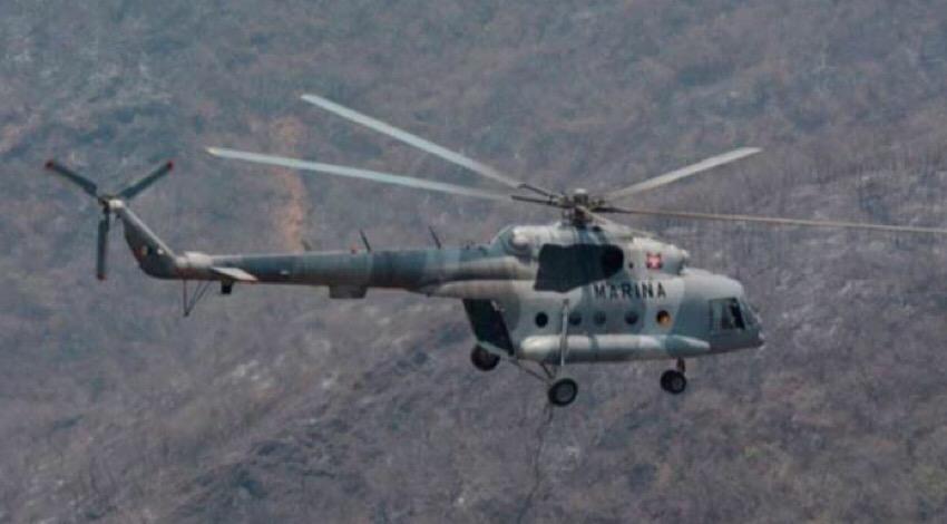Buscan a sobrevivientes de caída de helicóptero
